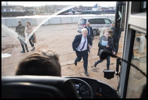 Johnson makes his way back onto his battle bus after visiting Wilton Engineering Services in Middlesbrough, November 20