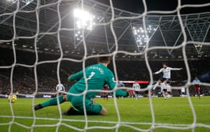Mo Salah fires home from the penalty spot to open the scoring at the London Stadium.
