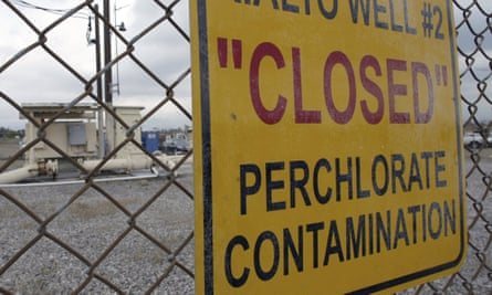 A sign posted outside a water well indicates perchlorate contamination at the site in Rialto, California.