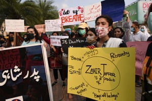 Women rights activists hold placards during a demonstration in Lahore against the brutal killing of Noor Mukadam, the 27-year-old daughter of a former Pakistani diplomat.