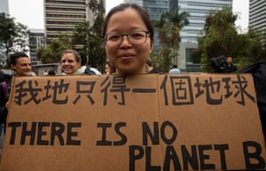 Young people take part in the worldwide climate strike in Hong Kong, China