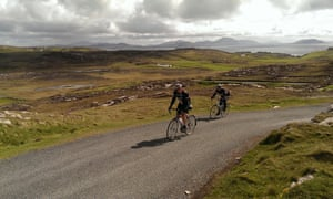 Two people road cycling in Ireland