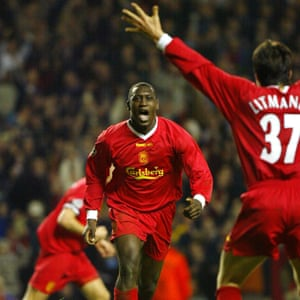 Emile Heskey celebrates with Jari Litmanen after scoring the second goal at Anfield.