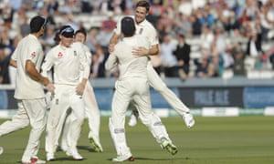 Chris Woakes celebrates taking the wicket of India's captain.