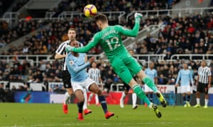 Newcastle United's Martin Dubravka heads clear from Manchester City's Raheem Sterling.
