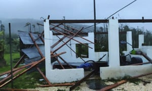 In this photo provided by Glen Hunter, damage from Super Typhoon Yutu is shown outside Hunter's home in Saipan, Commonwealth of the Northern Mariana Islands, on Thursday.