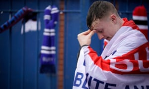 A Bury supporter outside the club's Gigg Lane stadium on Wednesday.
