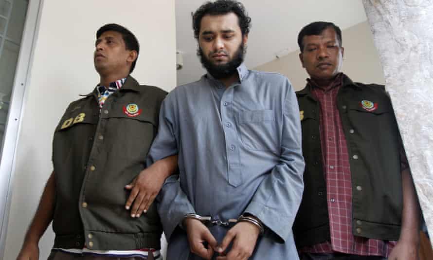 Samiun Rahman in handcuffs, flanked by police