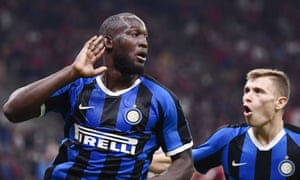 Romelu Lukaku cups his ear to the crowd after scoring Inter's second goal against Milan in the derby.