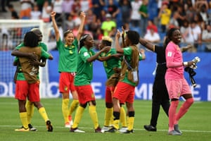 Cameroon's players celebrate after their astonishing last minute victory.