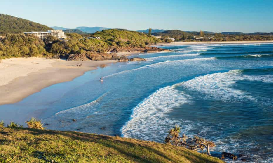 Surfers catching a morning wave at Cabarita Beach.