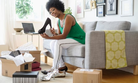 Woman opens boxes of shoes bought online