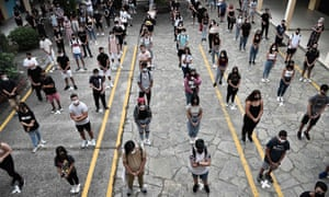 High school students keep a social distance on the first day of classes in Thessaloniki, Greece.
