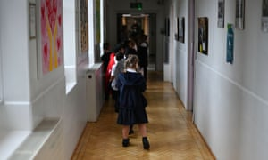 Pupils walk through the one-way-system in the corridors at St Luke's Church of England Primary School in East London