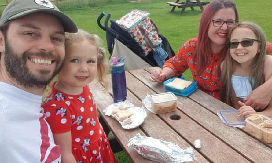 Gemma, her partner and her two girls having a picnic