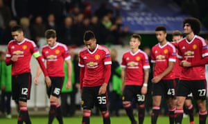 Glum faces all round as the Manchester United players leave the pitch after their 3-2 defeat to Wolfsburg, which saw them eliminated from the Champions League.