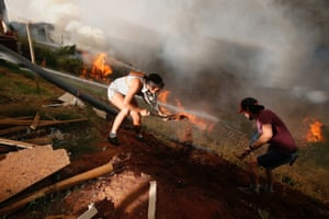 Residents in Viña del Mar, Chile, work to prevent a wildfire from spreading to their homes