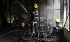 Firefighters in Barda, Azerbaijan, tackle a blaze at a residential building damaged by shelling