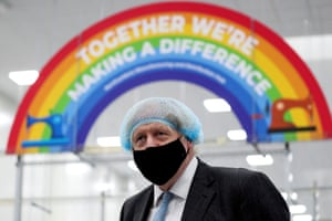 Britain's prime minister Boris Johnson visits a PPE manufacturing facility on 13 February.