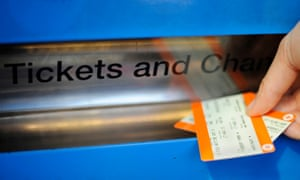 a passenger collects tickets from a machine