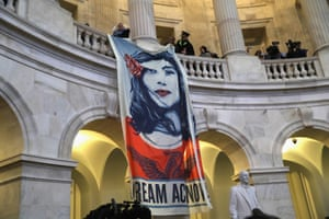Immigration activists protest inside the rotunda of the Russell Senate office building on 7 February.