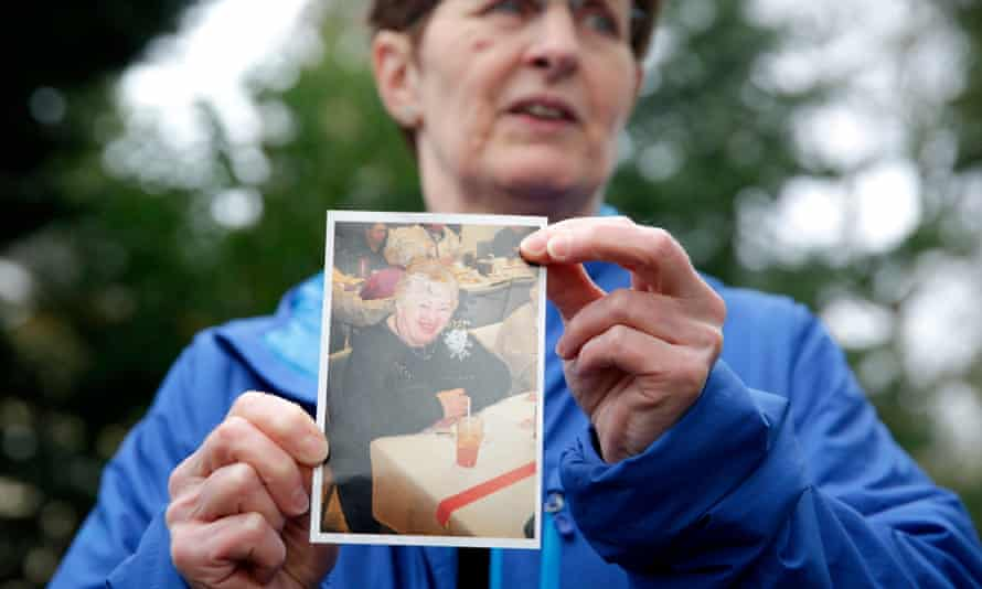 Pat Herrick holds a photo of her mom Elaine Herrick, 89, a resident of Life Care Center who died at the nursing home in Kirkland, Washington, on 5 March.