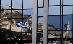 Sculpture of ancient Greek goddess Athena and the Greek flag are reflected in a building