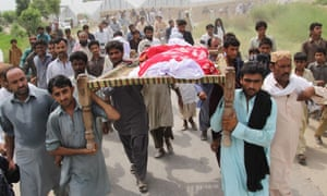 Relatives and neighbours carrying Baloch at her funeral.