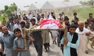 Male relatives and neighbours carry the body of social media celebrity, Qandeel Baloch during her funeral on July 17