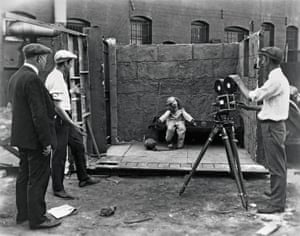 Child star Virginia Davis on an outdoor set for the finale of Alice's Spooky Adventure (1924), one of Walt Disney's early silent short films, which mixed live action with animation. Disney (second from left) directs.