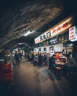 Street food diners and bars in the Yūrakuchō district, Tokyo. The Yūrakuchō district offers a glimpse of city life from the early postwar years, with lots of izakayas (bars) and yakitori stalls in the tunnels that run under the railway tracks – the antithesis of the fine dining trend.