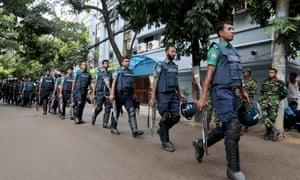 Bangladeshi policemen patrol in Dhaka after an attack by the New Jama'atul Mujahideen Bangladesh (JMB) militant group on a bakery in 2016.