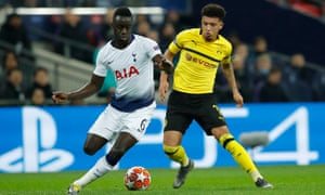 Dortmund's Jadon Sancho (right) contests a challenge with Davinson Sánchez of Tottenham in their Champions League last-16 first leg at Wembley.