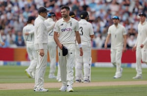 A dejected James Anderson is consoled by Joe Root after he had a wicket overturned on review.