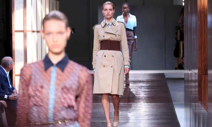 Model wearing a trench coat in Burberry's spring/summer show at London fashion week in September.