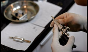 Tattooist Xing Haisong at work in his parlour