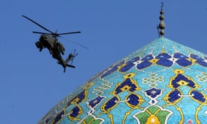 Technology v religion: a US Apache helicopter flies past a mosque in in Baghdad, Iraq, 2003.