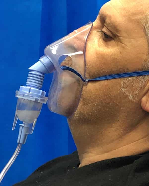 Simon Hattenstone, photographed by his daughter in hospital on 20 February with a nebuliser over his nose and mouth