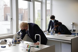 Boris Johnson attending a science lesson at King Solomon Academy in Marylebone, London, earlier today.