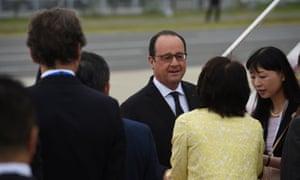 France's President Francois Hollande arrives at Chubu Centrair international airport in Tokoname.