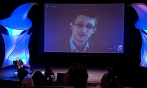 Whistleblower Edward Snowden participates in a video conversation with John Perry Barlow in 2014.