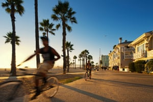 Cyclists on the coastal cycle trail through Venice Beach.