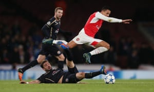Dinamo Zagreb's Goncalo Santos slides in to tackle Alexis Sanchez.