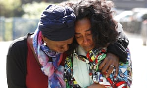 Pretana Morgan, right, is comforted by a friend