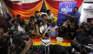 Activists cut a cake as they celebrate in Mumbai