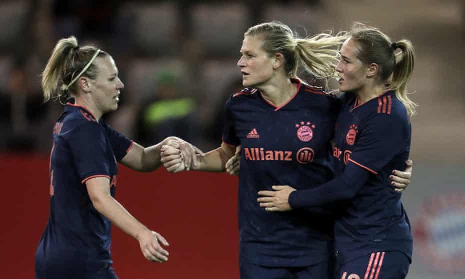 Bayern Munich's Carina Wenninger, Kristin Demann and Sydney Lohmann celebrate against BIIK Kazygurt during the Women's Champions League round of 16 match.