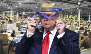 Donald Trump looks through a face shield at Ford's Rawsonville Components Plant in Ypsilanti, Michigan.
