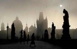 Prague, Czech Republic The sun rises over the medieval Charles Bridge