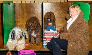 Woman wearing a coat that resembles her dogs' brown coats, at Crufts dog show 2019