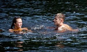 People swim in the River Wharfe near Ilkley